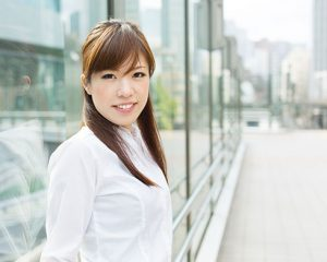 Asian Woman Standing Outside