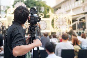Camera Operator Filming Event