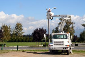 Utility Worker Installing a Close-Circuit Video Camera