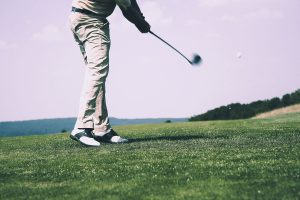 Man Hitting Golf Ball