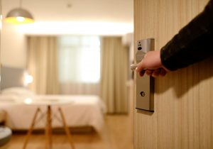 Man Opening Door to Hotel Room