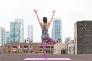 Woman on Rooftop in Yoga Pose